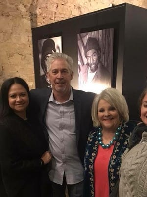 "From left: Photographer James Hall and his wife stop for a snapshot with Candis Rodgers Hicks, founder of the ""Somebody's Rusty"" ministry in San Angelo and Camille Santry, during the ""Sin Hogar"" photography exhibit at Raw 1899 on Jan. 4."