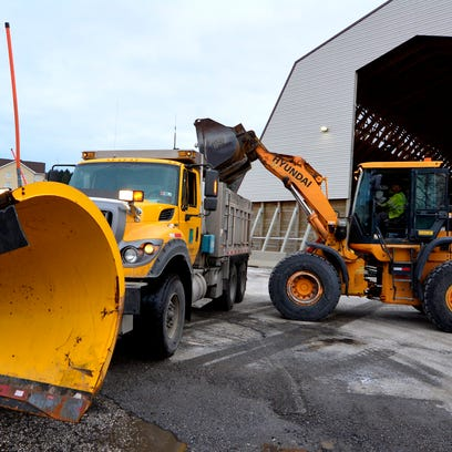 Salt is loaded into PennDOT plow trucks at the storage