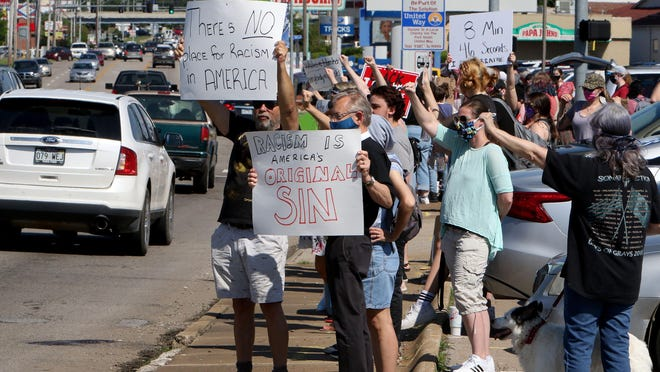 Supporters line the South side of Rogers Avenue, Thursday, June 4, 2020, at the corner of Waldron  Rd., during a Justice For George Floyd Protest.