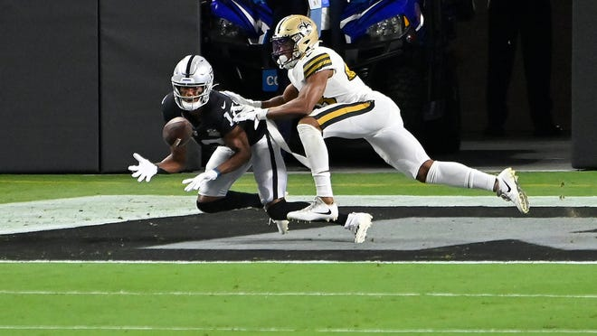 Raiders wide receiver Zay Jones, left, catches a touchdown pass against Saints free safety Marcus Williams (43) during the first half Monday night in Las Vegas.