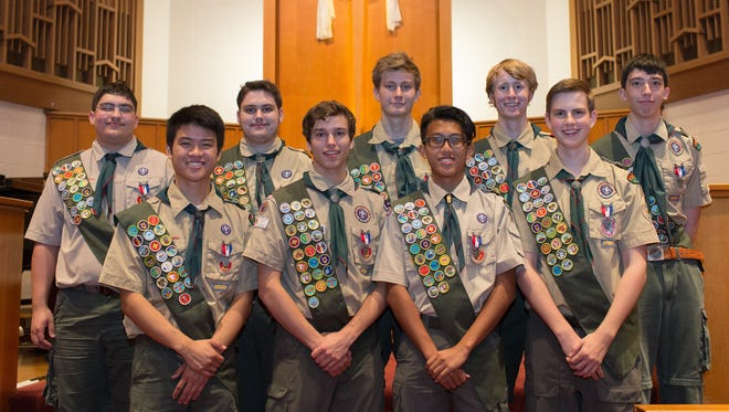 """Eagle Scouts from Boy Scout Troop 17 gather for a group photo following a court of honor ceremony for eight of the scouts at Blakemore United Methodist Church in Nashville, Tenn. Front row, from left are: Able Shi, Joseph Prochaska, Jay Sirikhandha and Nathan Mennen. Back row, from left are: Michael Mohieddin, Zack Bapty, Frank DuBose, Cole Porter and Michael """"Trey"""" Williams. Mennen was honored in a May 2013 ceremony. The other eight were honored in the May 17 service at Blakemore United Methodist Church. All nine scouts had been together since Cub Scouts. Photo by Mike DuBose."""