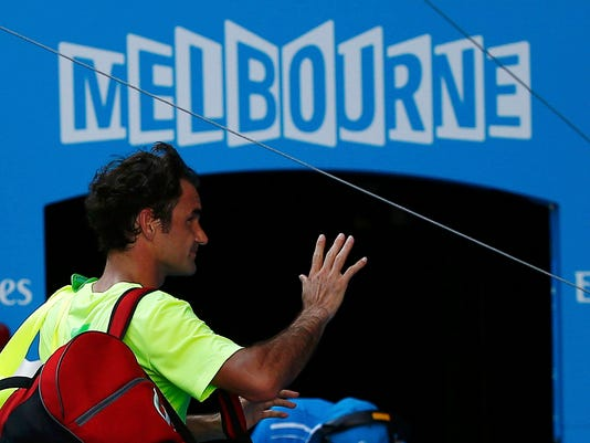 Roger Federer of Switzerland reacts as he walks off court after being defeated by Andreas Seppi of Italy in their men's singles third round match at the Australian Open 2015 tennis tournament in Melbourne