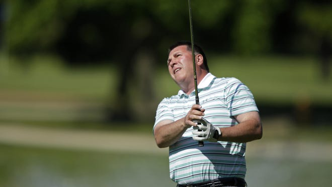 Tom Martine watches his tee shot on the second hole during the final round of the Appleton City Golf Tournament on Sunday at Reid Golf Course.