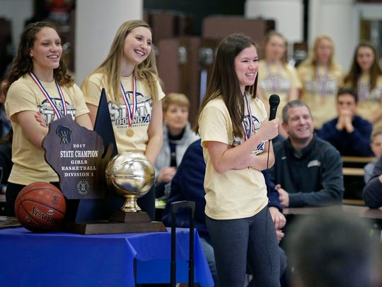 Appleton North players Callie Pohlmann, left, Sydney Levy and Kari Brekke talk with fans as the school holds a state championship celebration for the girls basketball and cheer teams Sunday, March 12, 2017, at Appleton North High School in Appleton, Wisconsin.