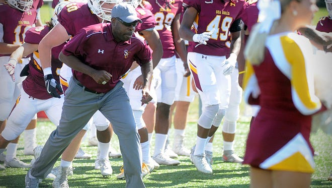 Salisbury University head football coach Sherman Wood leads the Sea Gulls onto the field before their battle with Montclair State on Saturday, Sept. 17, at Sea Gull Stadium in Salisbury.