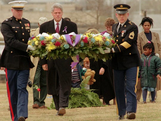 President Bill Clinton walks with U.S. Marine Corps