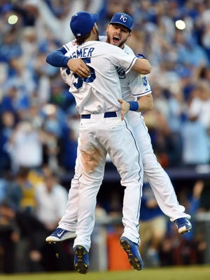 Royals infielders Eric Hosmer and Mike Moustakas celebrate after the Royals won the AL pennant.