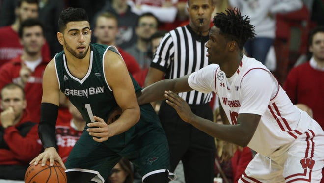 Green Bay Phoenix forward Kerem Kanter (1) attempts to keep the ball from Wisconsin Badgers forward Nigel Hayes (10) at  the Kohl Center on December 14, 2016.