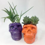 Visit the dollar store to pick up plastic skulls, that can then be transformed into Day of the Dead crafts.