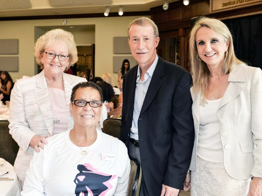 Pat Alley, left, Friends in Pink President Cheryl Norman Caldwell, Dr. John and Catherine Fasano celebrate the Super Heroes of Breast Cancer at the Friends in Pink annual luncheon on Oct.7.