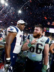Bryan Stork, left, celebrates winning the Super Bowl