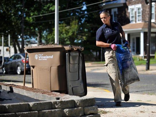Vineland Police Officer Carolina Gonzalez adds mulch