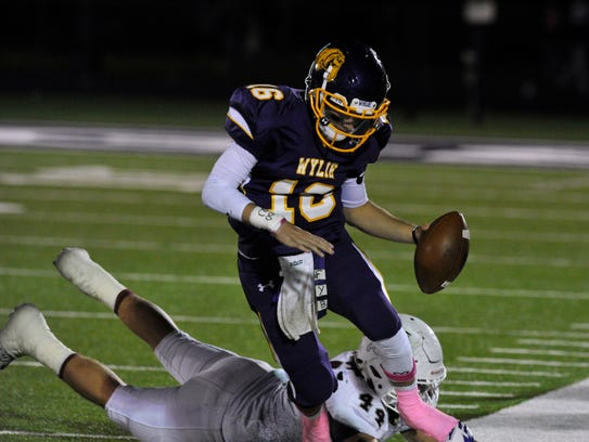 Wylie High School quarterback Sam King outruns Brownwood High School defensive end Hayden Tunnell to the sideline during Friday's game Oct. 13, 2017. Wylie won, 45-38.
