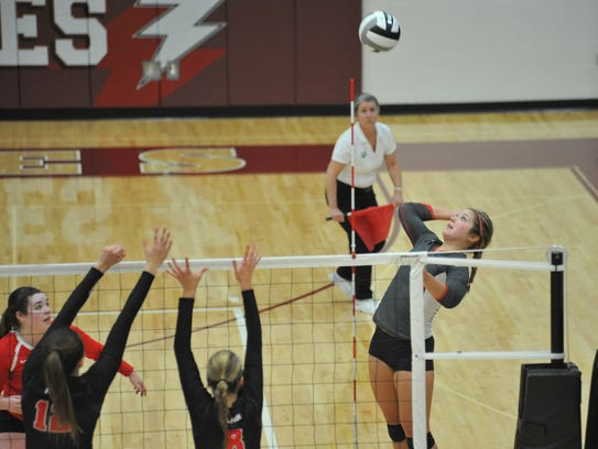 Jenna Karl hits a cross-court shot in the district final.