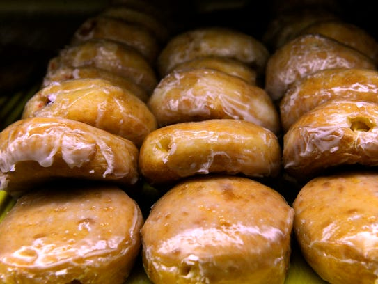 Jelly and cream-filled doughnuts for sale at Mustang Donuts Wednesday.