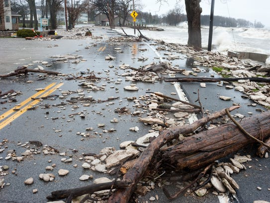 Debris is scattered across East Bayshore Road on the