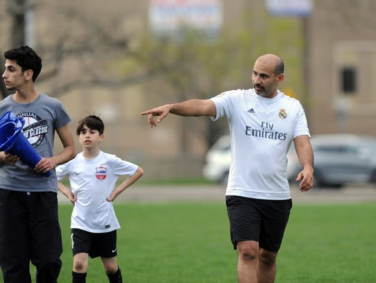 Michigan Futball Club founder Abbas Al-Wishah, right,