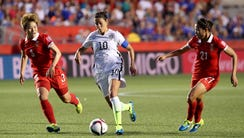 Carli Lloyd #10 of the United States controls the ball