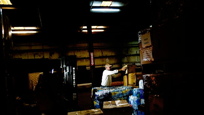 Don Owen, director of God's Warehouse Disaster Relief, loads a pallet of water at God's Warehouse, part of the Nolachucky Baptist Association's Disaster Relief effort in Morristown, Tennessee, on Thursday, September 28, 2017. Crates of food, water, clothing and other supplies are beginning to be shipped out from the warehouse to Puerto Rico this week.