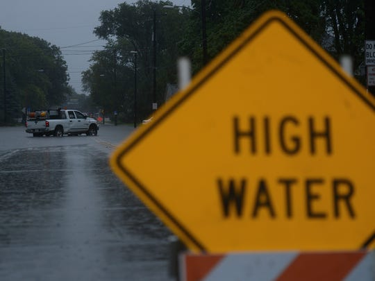 Shawano Avenue was blocked off Tuesday morning due to high water near Woodlawn Avenue in Green Bay.
