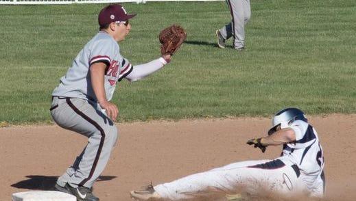 Byram Hills pitcher Frankie Vesuvio slides under the tag of Harrison second baseman.