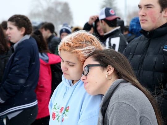 Students brave the cold and snow during a walkout Wednesday