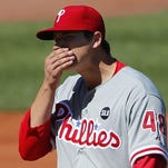 Philadelphia Phillies starting pitcher Jerad Eickhoff (48) wipes his face after giving up a hit during the second inning against the Boston Red Sox at Fenway Park.