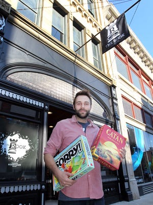 Zack Leopold, who with his wife, Celina, owns Rook, a board game parlor/bar/restaurant in the Over the Rhine, outside the business.