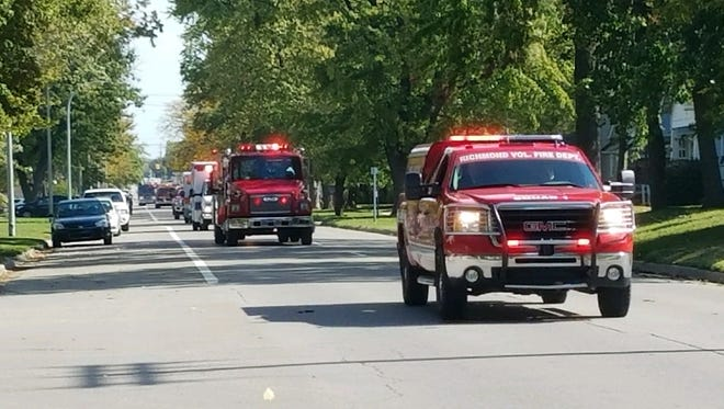 Emergency vehicles lead a procession, escorting Jon-Marc Chandler to rest on Saturday, Oct. 7, 2017. The Fort Gratiot firefighter and Tri-Hospital paramedic died in a motorcycle crash on Tuesday, Oct. 3, 2017.
