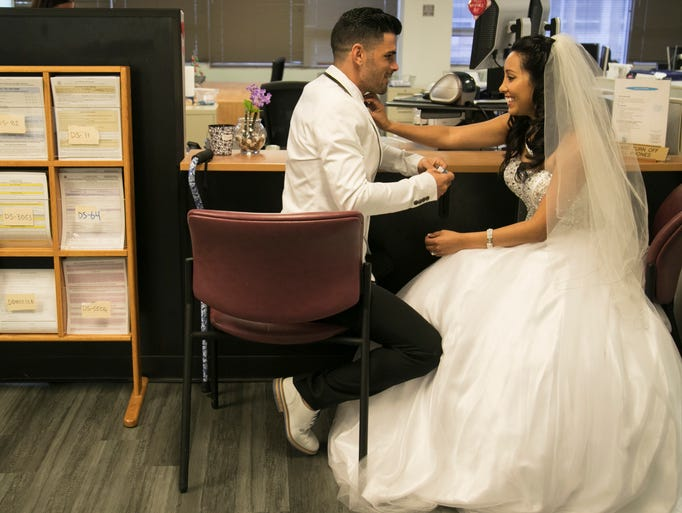 Patricia and Jorge Fragas wait for their wedding ceremony