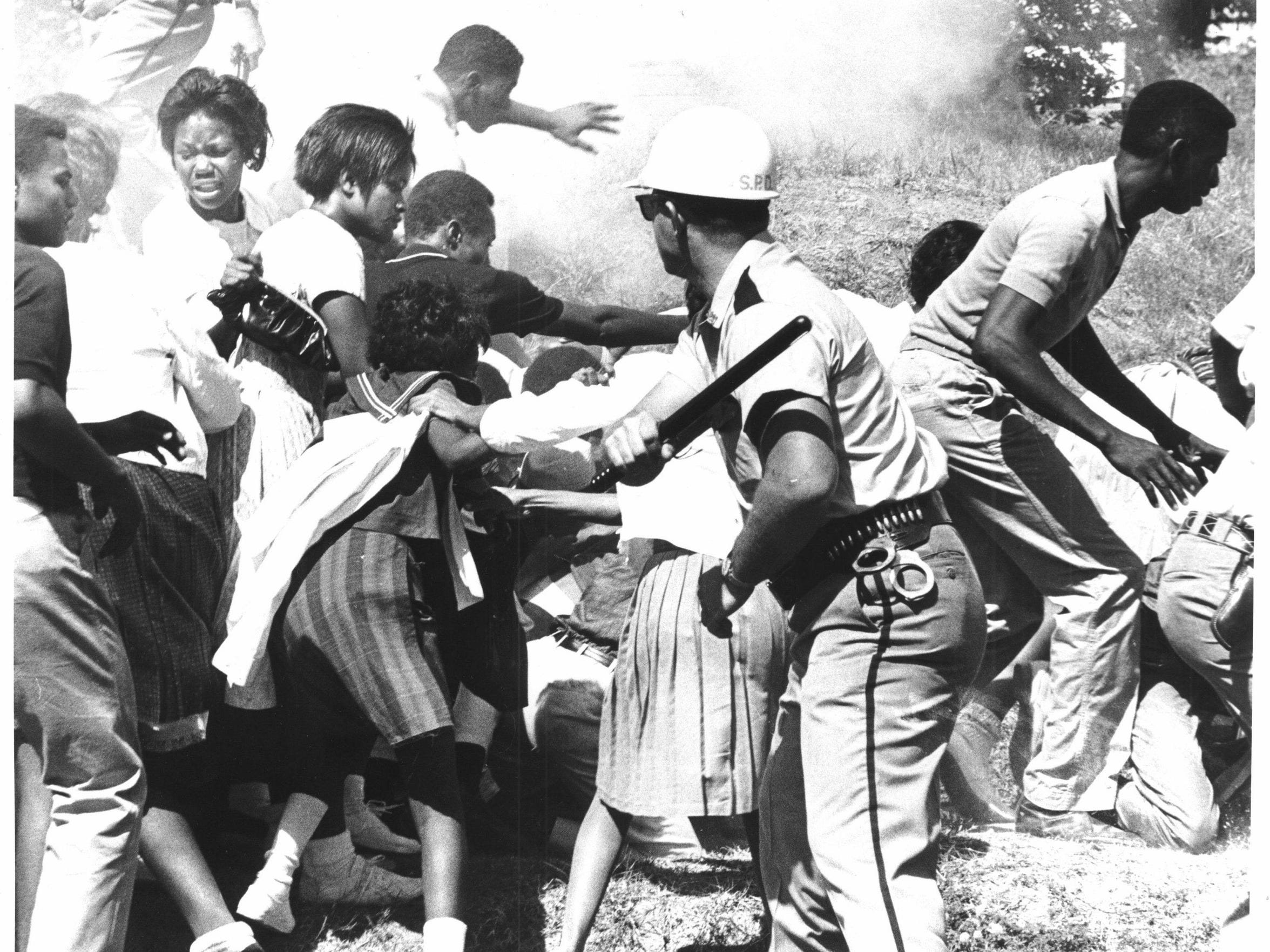 A Sept. 23, 1963, photo of student unrest at Booker T. Washington High School broken up by Shreveport police and other area law enforcement.