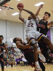 Jordan Adebutu (22, center) goes for two against William Carey defenders Brandon Cranford (1, right) and Branden Sheppard (14, left) . The Louisiana State University of Alexandria Generals won 91-72 over William Carey University Wednesday, Nov. 7, 2018 at the Fort.