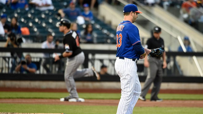 Justin Bour's home run helped the Marlins extend Matt Harvey's winless streak to five starts.