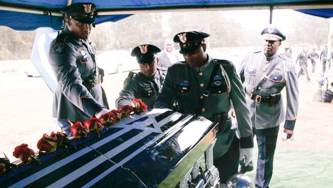 Baton Rouge police officers bid farewell Monday to their colleague Cpl. Montrell Jackson, one of three Baton Rouge law enforcement officers killed in a July 17 shootout, following his internment ceremony in Baton Rouge.