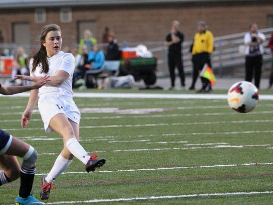 Mikayla Rosman fires a shot on goal against Veritas