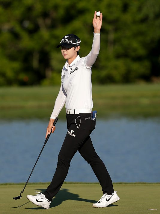 South Korea's Sung Hyun Park reacts after sinking a putt on the 18th green to finish the final round of the U.S. Women's Open Golf tournament Sunday, July 16, 2017, in Bedminster, N.J. Park won the tournament. (AP Photo/Seth Wenig)