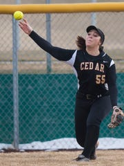 Cedar's Denim Henkel helped power the Lady Reds to the Region 9 softball title with a solo home run on Friday.