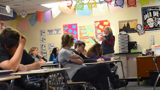 Abby Adams teaches seventh and eighth grade students Spanish Tuesday in the Algonac Junior/Senior High School. The middle school grades were added to the high school this fall as part of the schools' redistricting.