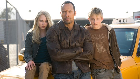 "It's AnnaSophia Robb (left), Dwayne Johnson and Alexander Ludwig against the government in ""Race to Witch Mountain."""