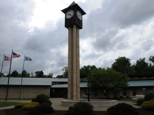 Ontario municipal building, with the city's clock tower in the foreground