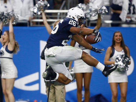 Penn State running back Saquon Barkley (26) scores a 92-yard touchdown run during the first half of Saturday's Fiesta Bowl against Washington in Glendale, Arizona. Penn State defeated the Huskies 35-28.