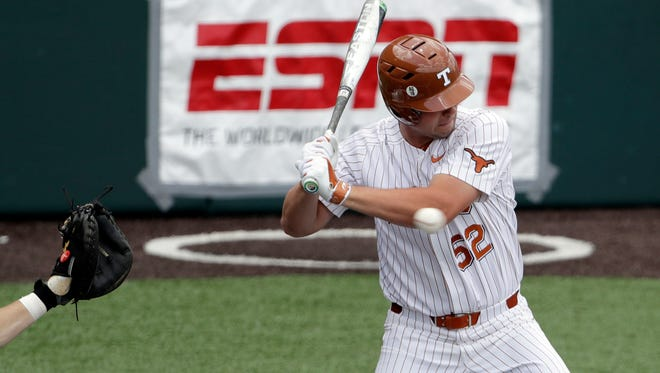 Texas' Zach Zubia (52) is hit with a pitch by Tennessee Tech pitcher Ethan Roberts (not shown) in the fifth inning Monday.