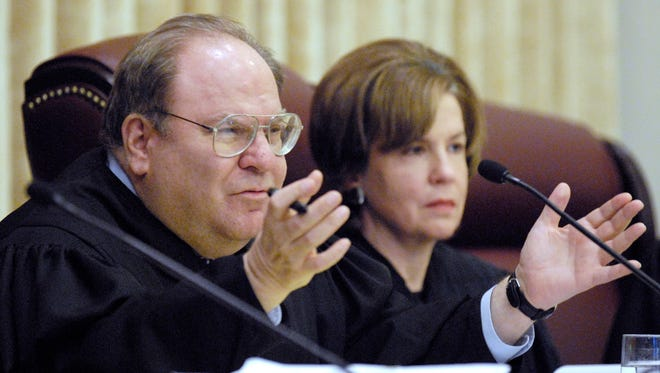 In this Feb. 27, 2008 file photo, Missouri Supreme Court Judge Richard B. Teitelman asks a question of attorneys as they present their case in the Missouri Supreme Court in Jefferson City. A court spokesperson said Tuesday, Nov. 29, 2016, that Teitelman has died, but provided no other details. Teitelman had served on the court since March 2002 and was chief justice from July 2011 through June 2013.