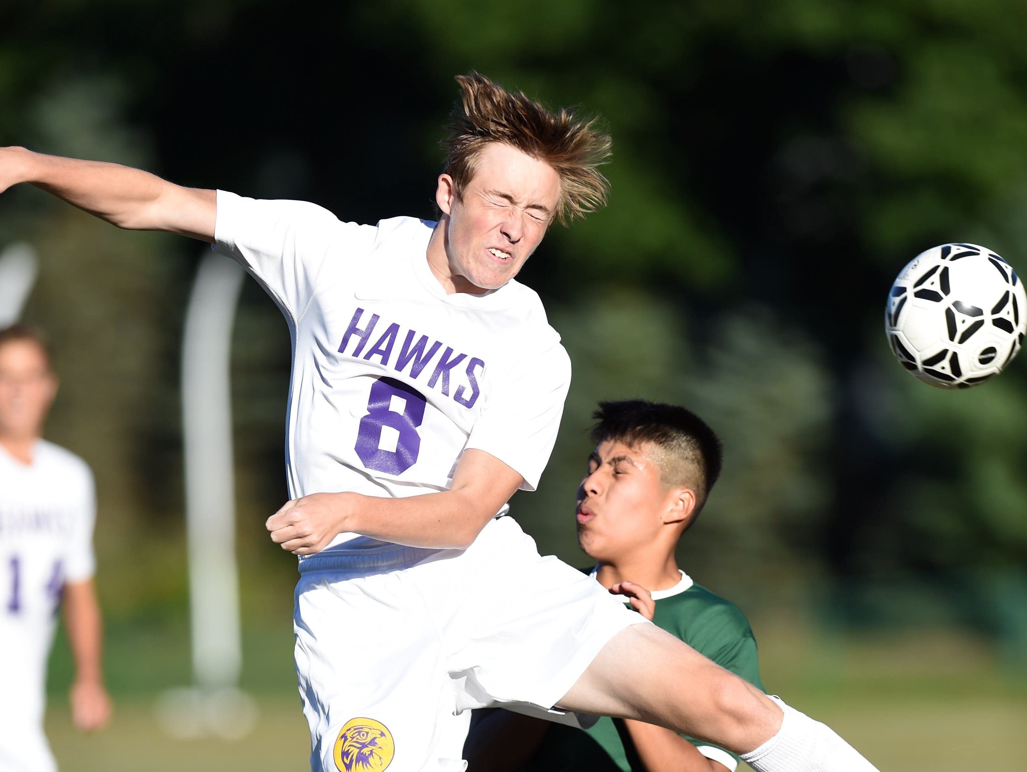 Rhinebeck's Nate Shanahan goes up for a header against Webutuck's Omar Reyes during Thursday's game at Rhinebeck.