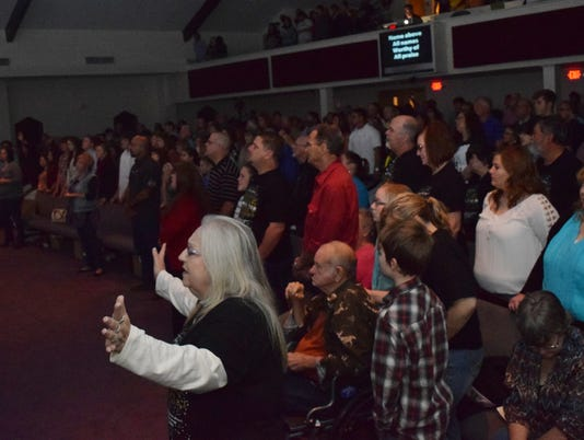 Journey Church members praise God in worship.