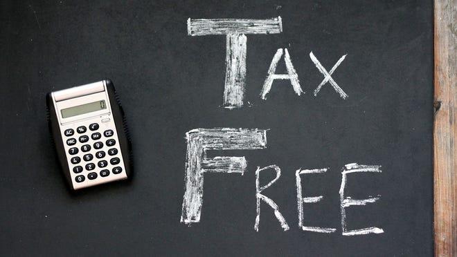 "Words ""tax free"" on blackboard, with calculator"