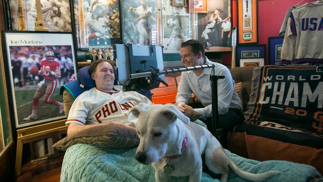 """Ron Hunting, left, at his Peoria home with speech therapist Robert Smith, co-wrote """"Postmarked,"""" which is currently in production. Hunting, who is battling Lou Gehrig's disease, based the script partly on his experiences as a Valley mail carrier."""