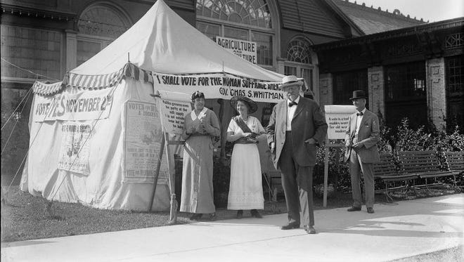 Mayor Hiram Edgerton, front, visiting the eighth Rochester Industrial Exposition in 1915, is photographed standing in front of the pro-suffragist tent.