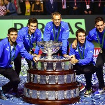 Argentinian Davis Cup team players (L-R) Federico Delbonis, Guido Pella, captain Daniel Orsanic, Leonardo Mayer, and Juan Martin del Potro pose with their trophy after defeating Croatia in the Davis Cup final in Zagreb, Croatia, 27 November 2016.