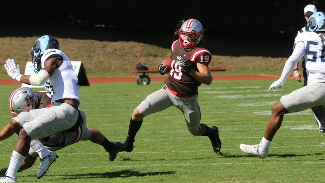 Brown's Jakob Prall looks for some running room against URI in last season's Governor's Cup game.